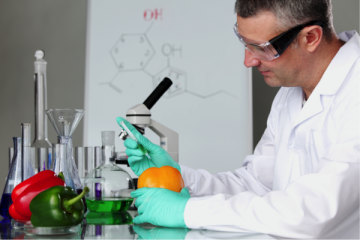 Picture of a man working in a food safety lab working a food safety career.
